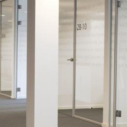 Separated offices created with glass partitions walls