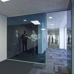 Blue colored glass and doors partitions walls