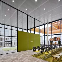 Inside a meeting room with partition walls and acoustic panels