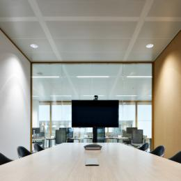 Inside a meeting room with a glass partition wall