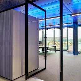 Aluminum framed pivoting door with glass at The Flow Houthavens Amsterdam.
