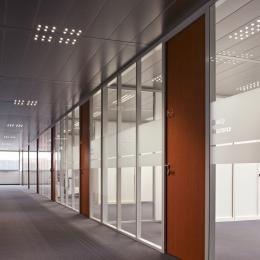 Office corridor with single glass partition walls