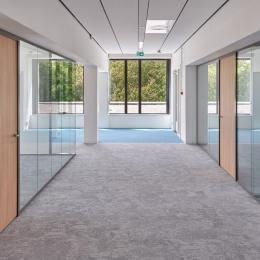 Corridor with glass partitions on both sides