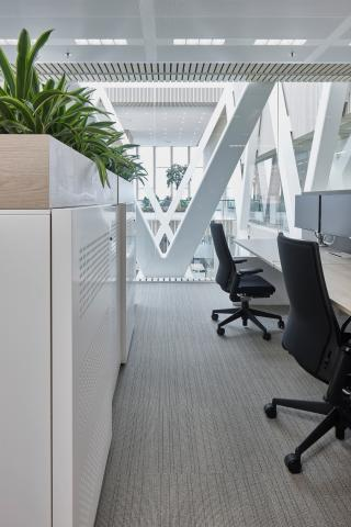 Office space with in the background a QbiQ Safety Glass partition