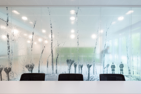 Double glass partition wall with design foil added at townhall Woerden