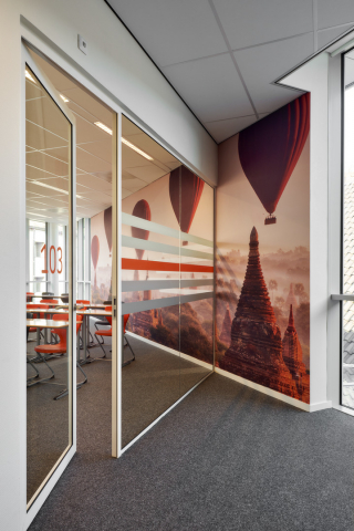 Glass partition wall and framed door at Seeligkazerne Breda, the Netherlands.