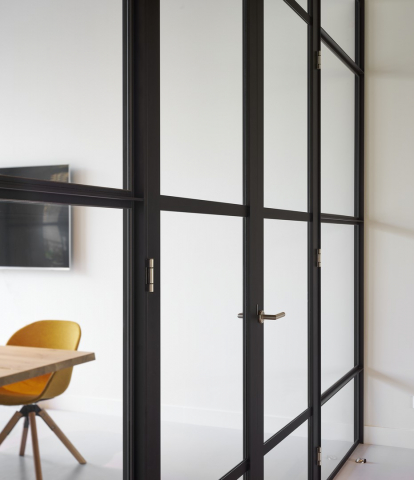 Double doors in a classic industrial glass wall