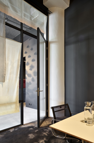 Modern industrial look wall with double glass and framed door