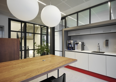 Kitchen with pantry built into IQ-Pro glass wall