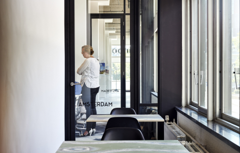 Double glass doors places in a industrial look glass wall