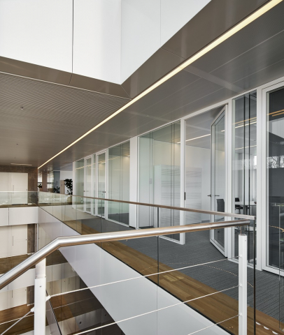 Glass office walls dividing the corridor