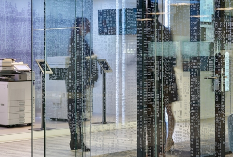 Vector pattern foil added to glass of a demountable office wall