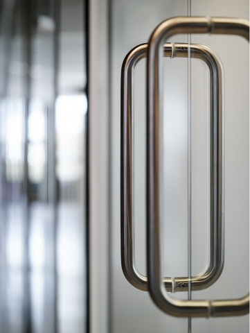 300 mm U-shaded door handle on a glass sliding door