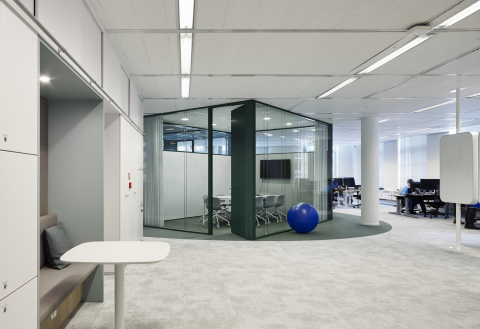 Small conversation room partial made of double glass and closed panels