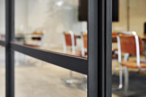 Closeup of an industrial look & feel glass office wall