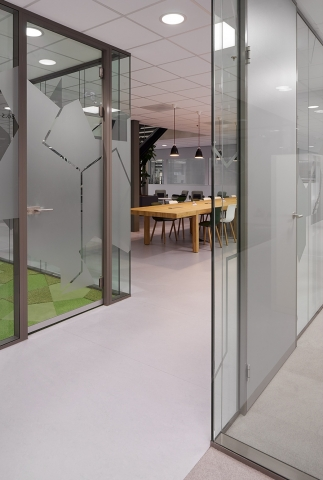 Multiple demountable partition walls with privacy film on the glass