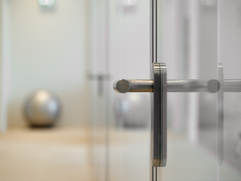 Flush door with glass panels positioned at the outside of the door