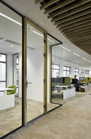 Single glass partitions wall combined with wood door frames
