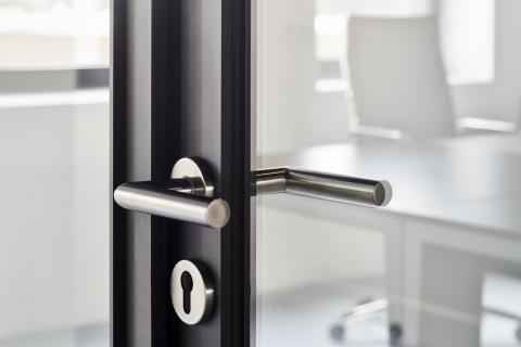 """Door handle """"Amsterdam"""" on a framed door"""