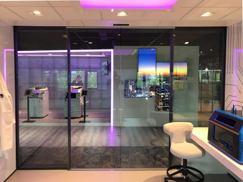 Electronic sliding doors in an IQ-Structural partition glass wall