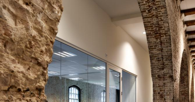 Modern glass wall combined with old stone walls